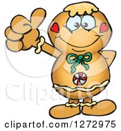 Clipart Of A Happy Gingerbread Man Giving A Thumb Up Royalty Free Vector Illustration