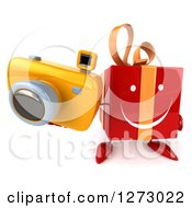 Clipart Of A 3d Red Gift Character Holding Up A Camera Royalty Free Illustration by Julos