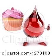 3d Hot Water Or Blood Drop Mascot Holding A Thumb Up And A Pink Frosted Cupcake