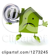 Clipart Of A 3d Unhappy Green House Character Jumping And Holding An Email Arobase Symbol Royalty Free Illustration by Julos