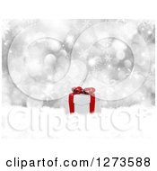 Clipart Of A 3d Christmas Gift In Snow Over Silver Bokeh And Snowflakes Royalty Free Illustration
