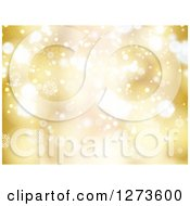 Clipart Of A Gold Christmas Snowflake Background With Bright Bokeh Flares Royalty Free Vector Illustration by KJ Pargeter