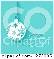 Clipart Of A Merry Christmas Greeting And Suspended Snowflake Bauble Ornament On Blue Royalty Free Vector Illustration