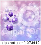 Clipart Of A 3d Row Of Christmas Baubles Suspended Over Purple With Snowflakes And Bokeh Royalty Free Vector Illustration by KJ Pargeter