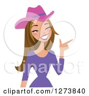 Clipart Of A Brunette Caucasian Cowgirl Winking And Pointing Royalty Free Vector Illustration