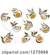 Clipart Of Leafy Brown Tea Cups And Kettles 2 Royalty Free Vector Illustration