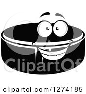Clipart Of A Grayscale Happy Hockey Puck Royalty Free Vector Illustration