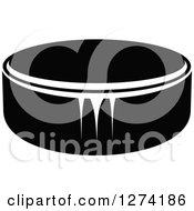 Clipart Of A Black And White Hockey Puck Royalty Free Vector Illustration