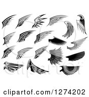 Clipart Of Black And White Wings In Different Styles Royalty Free Vector Illustration