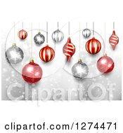 Christmas Background With 3d Suspended Silver And Red Baubles Over Snowflakes