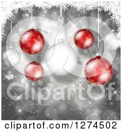 Clipart Of A Christmas Background Of 3d Red And White Suspended Baubles Over Silver With Bokeh Royalty Free Illustration