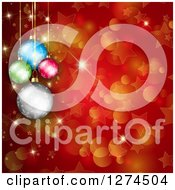 Clipart Of A Christmas Background Of Suspended Colorful Baubles Over Red With Bokeh And Stars Royalty Free Illustration