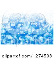 Clipart Of A Blue Christmas Background With Bokeh And Snowflakes Royalty Free Illustration