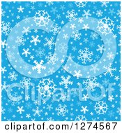 Clipart Of A Seamless Blue And White Winter Christmas Snowflake Background Royalty Free Vector Illustration