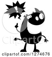 Clipart Of A Black And White Silhouetted Rhinoceros With An Idea Royalty Free Vector Illustration