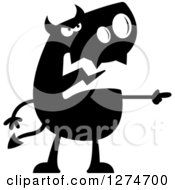 Clipart Of A Black And White Silhouetted Mad Devil Pointing Royalty Free Vector Illustration