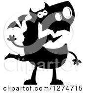 Clipart Of A Black And White Silhouetted Dragon Waving Royalty Free Vector Illustration