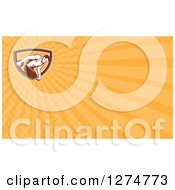 Clipart Of A Retro Discus Thrower And Orange Rays Business Card Design Royalty Free Illustration