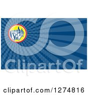 Clipart Of A Retro Mountain Goat And Blue Rays Business Card Design Royalty Free Illustration