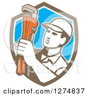 Clipart Of A Retro Male Plumber Holding A Monkey Wrench In A Brown White And Blue Shield Royalty Free Vector Illustration