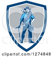 Clipart Of A Retro Woodcut Miner Prospector Man With Gear In A Blue White And Gray Shield Royalty Free Vector Illustration