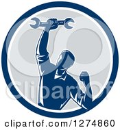 Clipart Of A Retro Mechanic Man Pumping His Fist And A Spanner Wrench In A Blue White And Gray Circle Royalty Free Vector Illustration