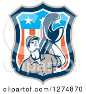 Clipart Of A Retro Mechanic Man Holding A Giant Spanner Wrench In An American Flag Shield Royalty Free Vector Illustration