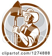 Clipart Of A Retro Woodcut Male Farmer Holding A Shovel In A Brown White And Gray Circle Royalty Free Vector Illustration