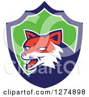 Clipart Of A Retro Fox Head In A Blue White And Green Shield Royalty Free Vector Illustration by patrimonio