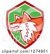 Clipart Of A Retro Fox Head In Profile Inside A Red White And Green Shield Royalty Free Vector Illustration by patrimonio