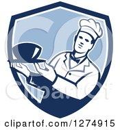 Clipart Of A Male Chef Holding A Bowl Of Soup In A Blue And White Shield Royalty Free Vector Illustration