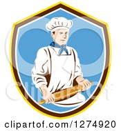 Clipart Of A Retro Male Chef Holding A Rolling Pin In A Yellow Brown White And Blue Shield Royalty Free Vector Illustration