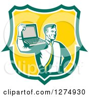 Clipart Of A Retro Computer Repair Or Business Man With A Laptop On His Shoulder In A Green White And Yellow Shield Royalty Free Vector Illustration