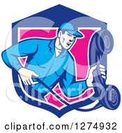 Clipart Of A Retro Telephone Repair Man Holding Out A Red Receiver In A Blue White And Pink Shield Royalty Free Vector Illustration by patrimonio