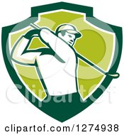 Clipart Of A Retro Male Golfer Swinging In A Green And White Shield Royalty Free Vector Illustration by patrimonio