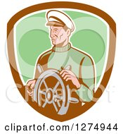 Clipart Of A Retro Male Sea Captain At The Wheel In A Brown White And Green Shield Royalty Free Vector Illustration by patrimonio