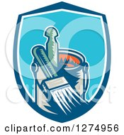 Retro Woodcut Paintbrush And Can In A Blue And White Shield