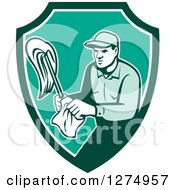 Retro Male Janitor With A Mop And Wipes In A Green And White Shield