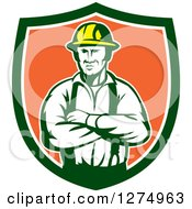 Clipart Of A Retro Male Electrician Or Construction Worker With Folded Arms In A Green White And Orange Shield Royalty Free Vector Illustration by patrimonio