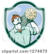 Clipart Of A Retro Worker Carrying A Log In A Green White And Blue Shield Royalty Free Vector Illustration by patrimonio