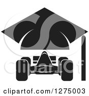 Clipart Of A Black And White Race Car And Graduation Cap Design Royalty Free Vector Illustration