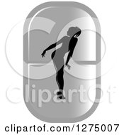 Clipart Of A Black Silhouetted Female Fitness Competitor Bending Over On A Long Silver Pill Royalty Free Vector Illustration