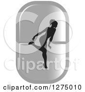 Clipart Of A Black Silhouetted Female Fitness Competitor Bending Over On A Silver Pill Royalty Free Vector Illustration