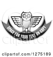 Clipart Of A Silver And Black Owl And Banner Icon Royalty Free Vector Illustration by Lal Perera