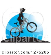 Clipart Of A Silhouetted Female Mountain Biker Jumping Against A Blue Circle Royalty Free Vector Illustration