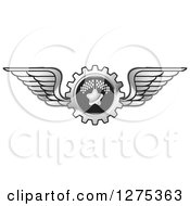 Clipart Of A Winged Racing Gear Cog Royalty Free Vector Illustration