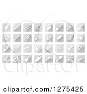 Clipart Of White Tool Icons On Gray Squares Royalty Free Vector Illustration by AtStockIllustration