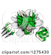 Clipart Of A Fierce Green Dragon Mascot Head Shredding Through A Wall Royalty Free Vector Illustration