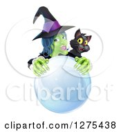 Clipart Of A Green Halloween Witch And Black Cat Behind A Crystal Ball Royalty Free Vector Illustration