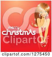 Clipart Of A Merry Christmas Greeting With A Beautiful Caucasian Woman Holding A Heart On A Red Background Royalty Free Vector Illustration by cidepix